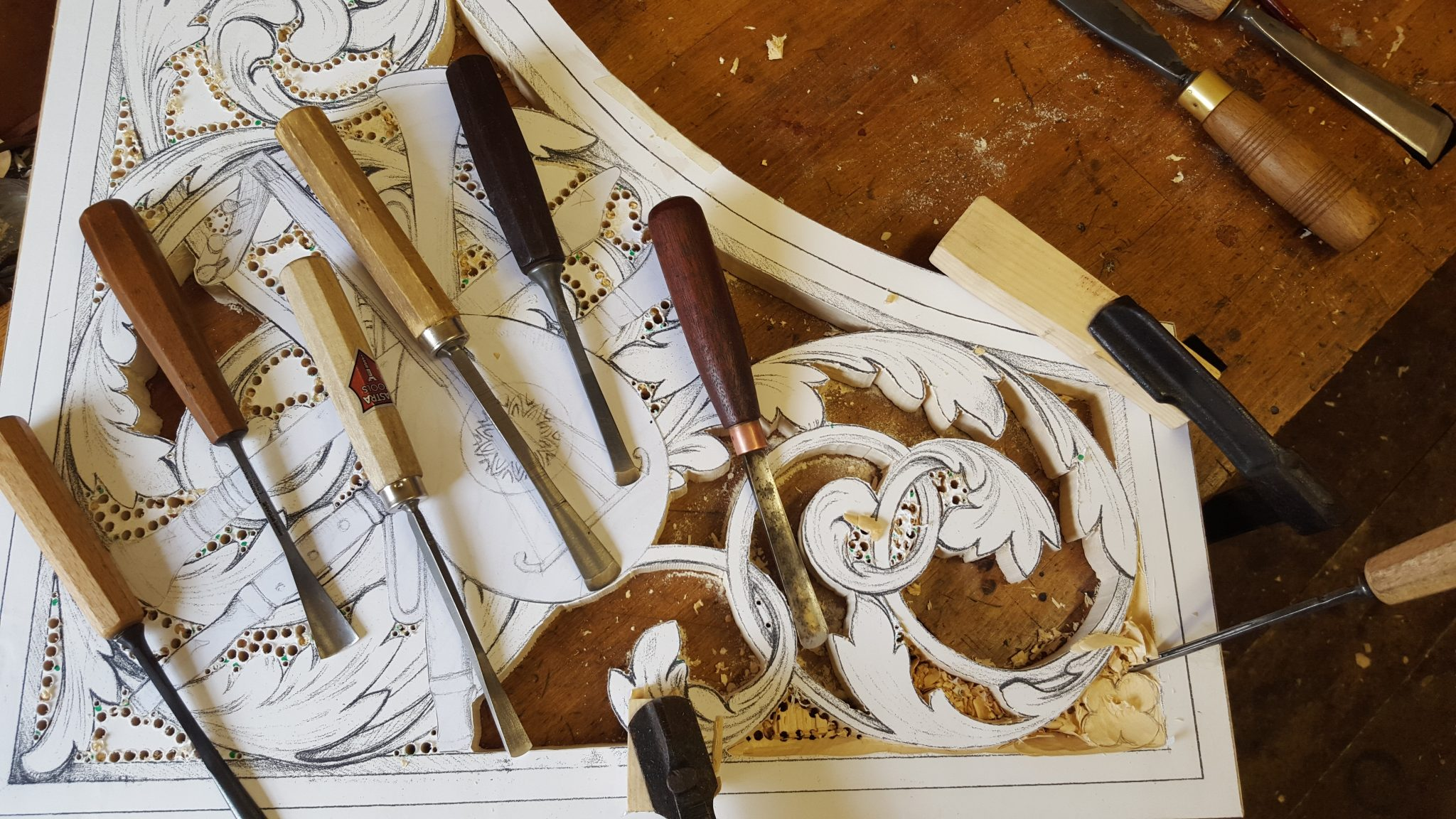 lime wood pipe shades carvings with trophy panel, lute, drawings by Laurent Robert Woodcarver
