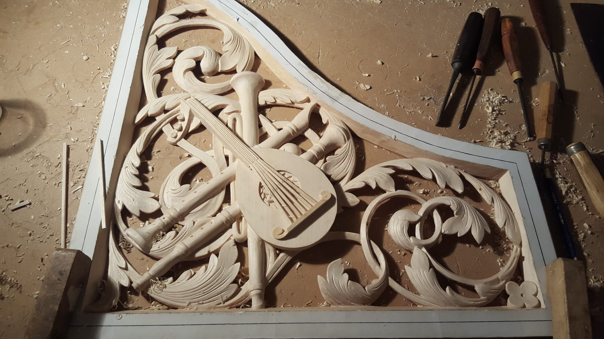 lime wood pipe organ carvings in Concord, Massachusetts  by Laurent Robert Woodcarver