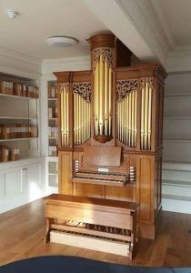 Westminster Abbey Song school, practice organ in room, Laurent Robert woodcarving