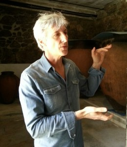 Vasco Croft of Aphros, in front of some of his amphorae. (Photo by Laurie Daniel)
