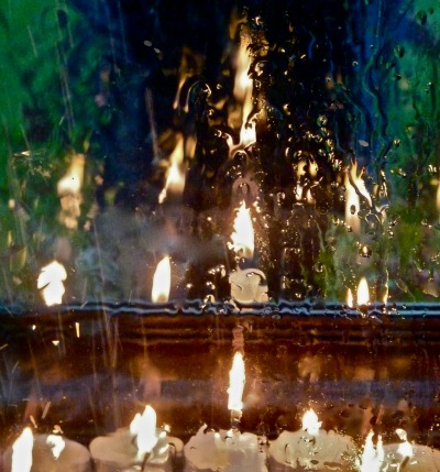Candlemass flames in Rainy Window
