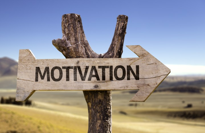 wooden sign says motivation - represents character motivation