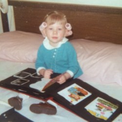 Me in curlers reading scrapbook