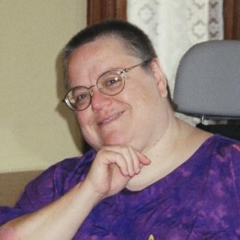Betty Rose Dudley, head shot in a purple shirt