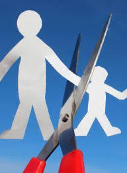 scissors cutting parent and child paper dolls apart