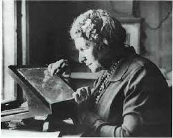 Photo of Annie Jump Cannon working at a tablet screen