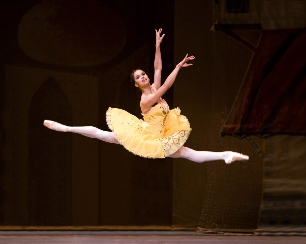 Black ballet dancer Misty Copeland in a mid-air split