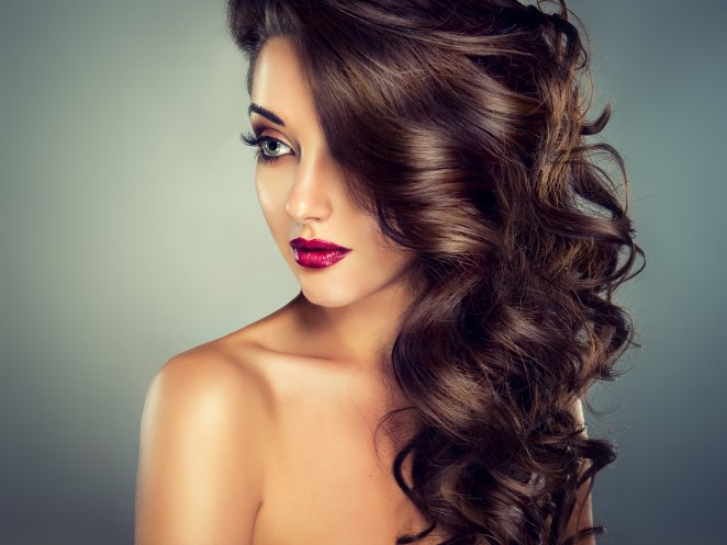 Model with beautiful curly hair, fashion, and makeup