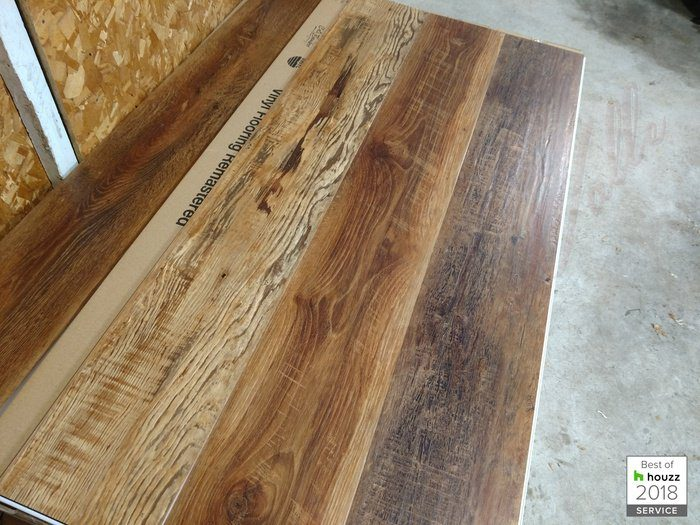 Is it vinyl? Actual hardwood? These waterproof SPC vinyl planks are the perfect flooring option for busy households that want that barn wood look.