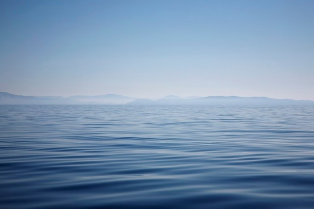 Ocean with mountains on horizon