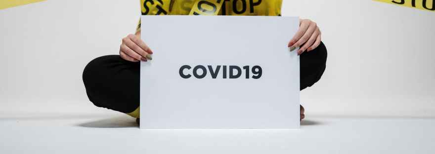 person holding covid sign