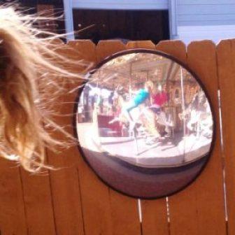 merry-go-round in mirror