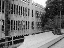Decorative pre-cast concrete details hide parking. Photo by author.