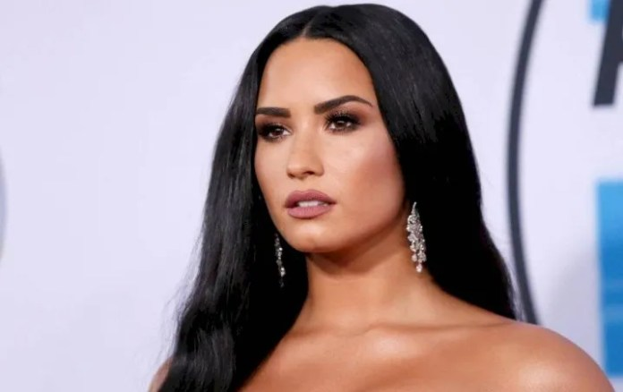 Demi Lovato climbs a burning picture showing their boobs