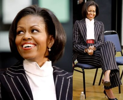 This suit is interesting because Michelle wears it with a red-statement belt, which I think works well, and a high-neck, turtle-neck-like blouse which I think is fantastic. More combinations of comfortable, chic turtlenecks should be worn with suits in the winters.