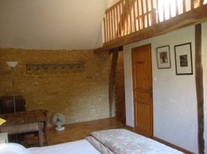 The mezzanine level in the second double bedroom is suitable for sleeping, or luggage storage.