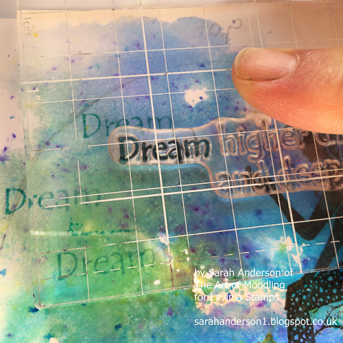 11 Using the blue distress inkpads, ink the word 'Dream' from the quote.