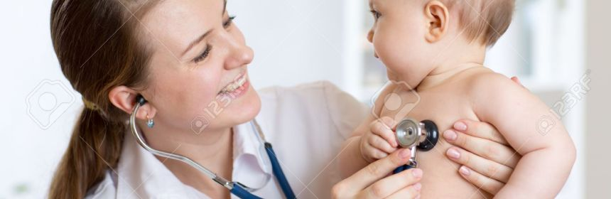 Cute pediatrician woman examining of baby kid in office