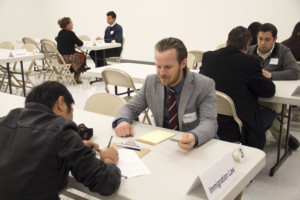 Law students assist clients at the new community legal clinic in Sugarhouse, part of the law school's pro bono initiative.