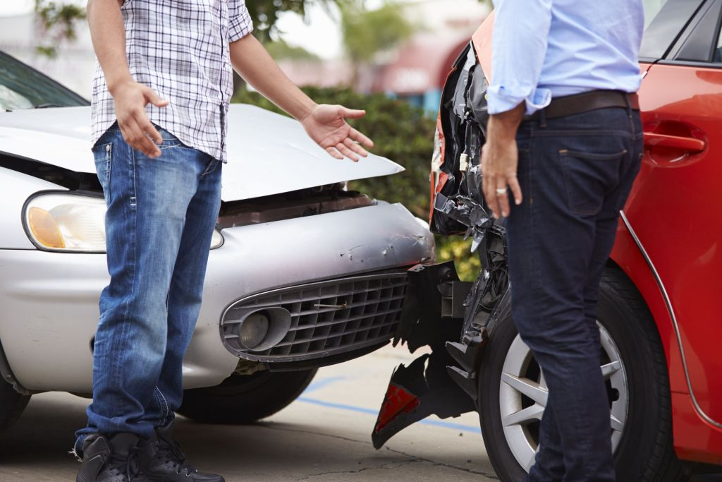 Two people talking after a crash