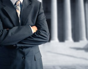 suited man in front of courthouse