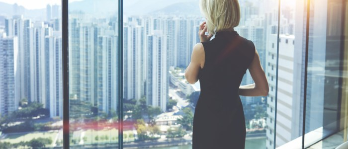 female CEO looks out window