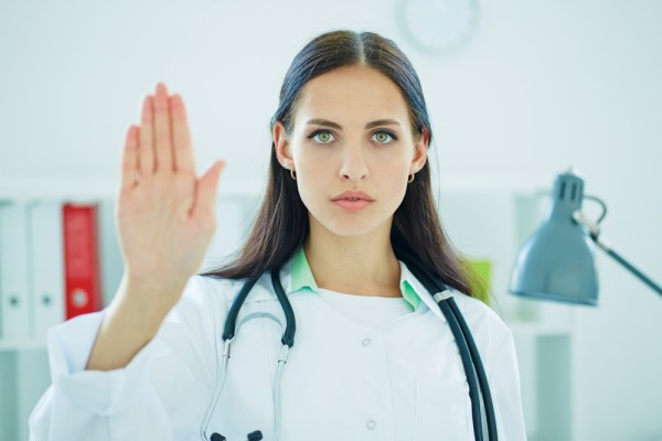female surgeon hand up in stop