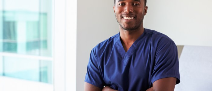 male nurse smiling with crossed arms