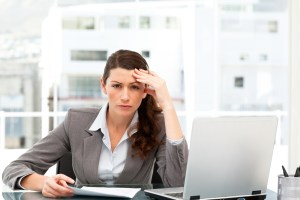 concerned business woman at computer