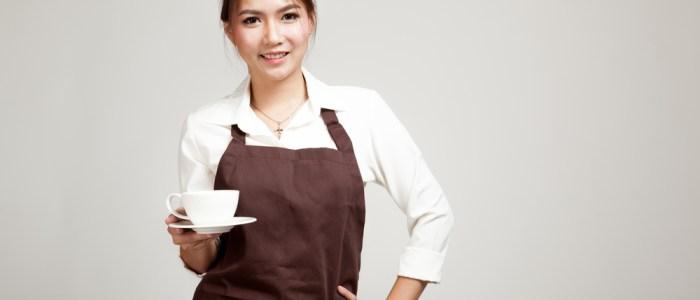 waitress with a mug and hand on hip