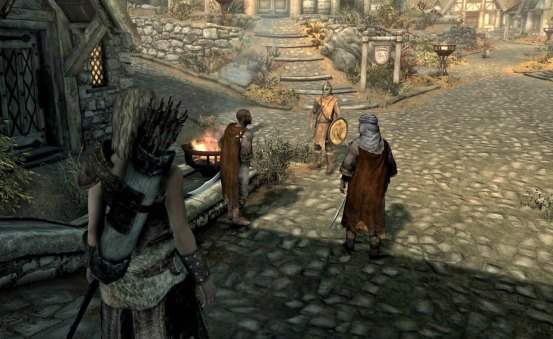 Whiterun guards confront Redguards at the city gate.