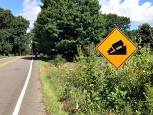 Steep hill ahead sign