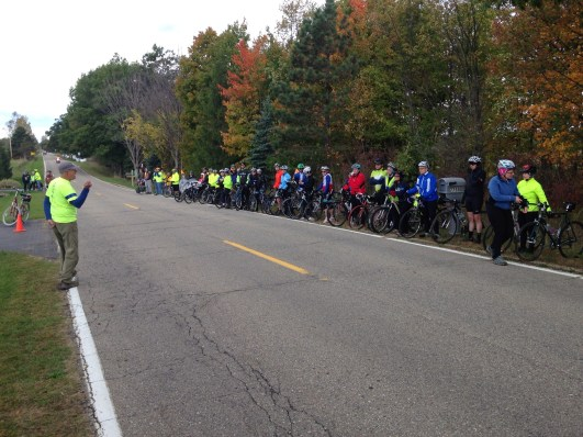 Cyclists on the Jill Byelich Tribute Ride stop at the crash site