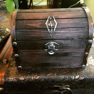Pic of a chest with a dragon emblem (from TheAlchemistsLibrary on Etsy)