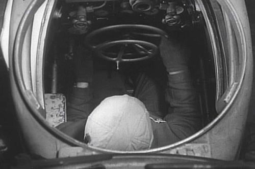Biber pilot in his cramped cockpit.