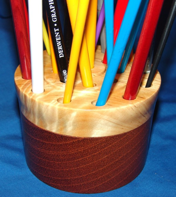 """Dennis Montville, """"Brush Holder"""", 48-18 - Hold 21 brushes so that bristles are protected from damage. Can also hold pencils. Medium wood turning, 3x4, $35"""