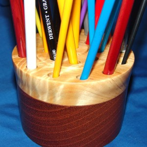 "Dennis Montville, ""Brush Holder"", 48-18 - Hold 21 brushes so that bristles are protected from damage. Can also hold pencils. Medium wood turning, 3x4, $35"