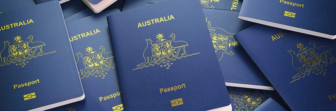 Austrailian passports denoting Austrailian citizenship are shown to emphasize the citizenship requirement.