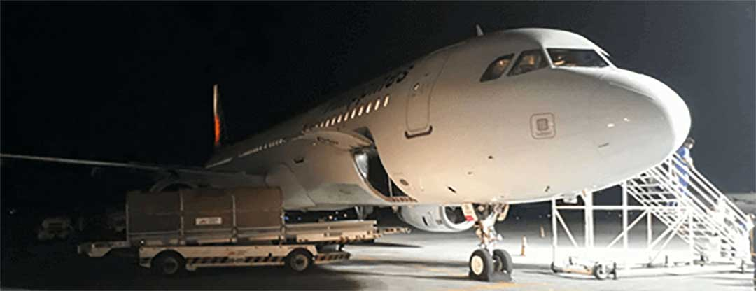 A PAL airplane at night, to signify international travel.