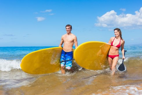 Couple with Stand Up Paddle Boards