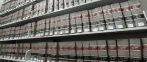 Rows of Florida Cases Reporter on metal shelves in law library