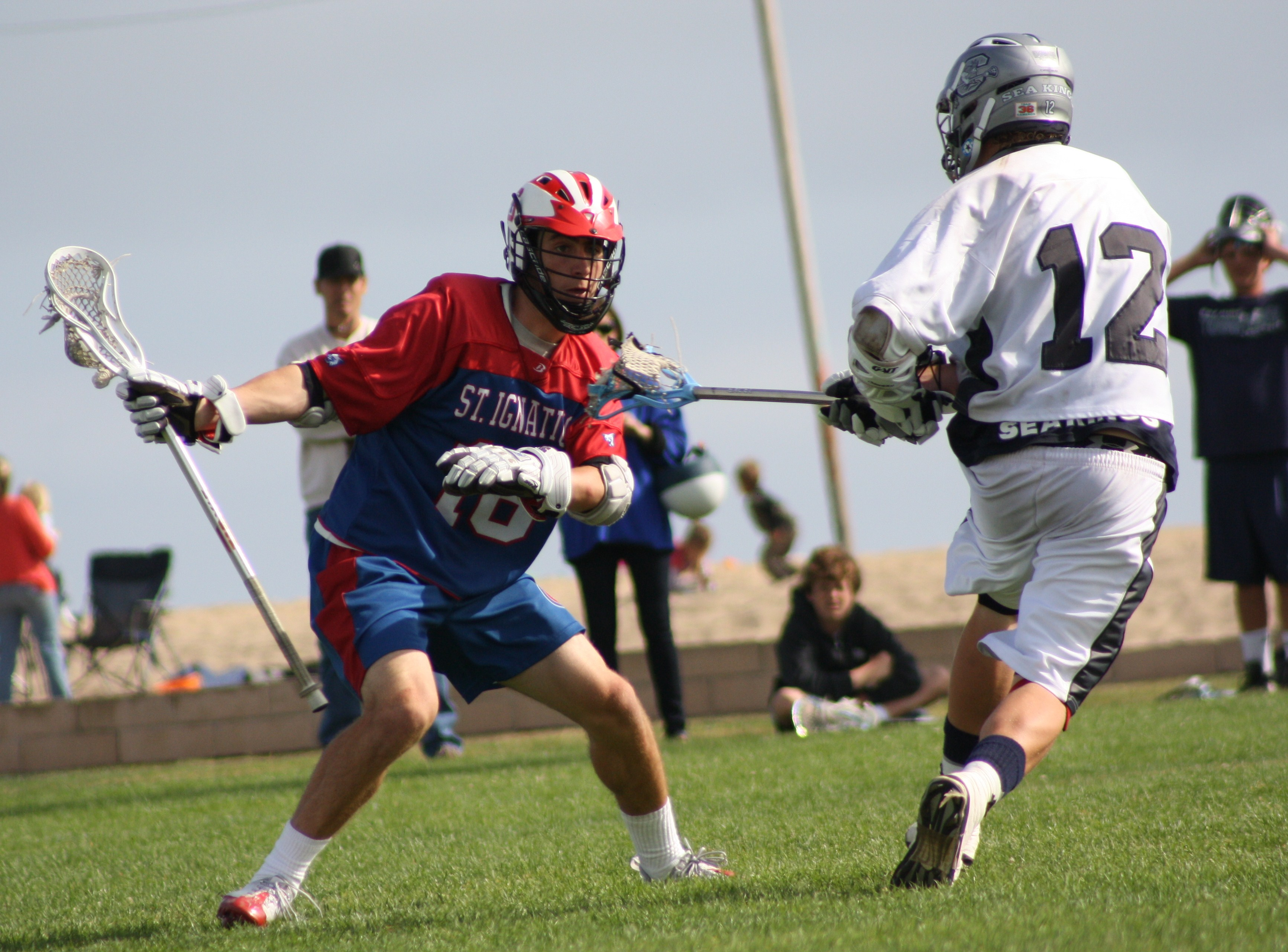 "St. Ignatius' Rob Emery battled Corona del Mar's Noah Molnar in ""Battle of Northern California and Southern California"" on May 2, 2009 at Peninsula Park in Newport Beach, CA. Photo by LaxBuzz"