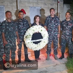 Ilham Shaheen lays a wreath at the memorial to the victims of the Beirut explosion