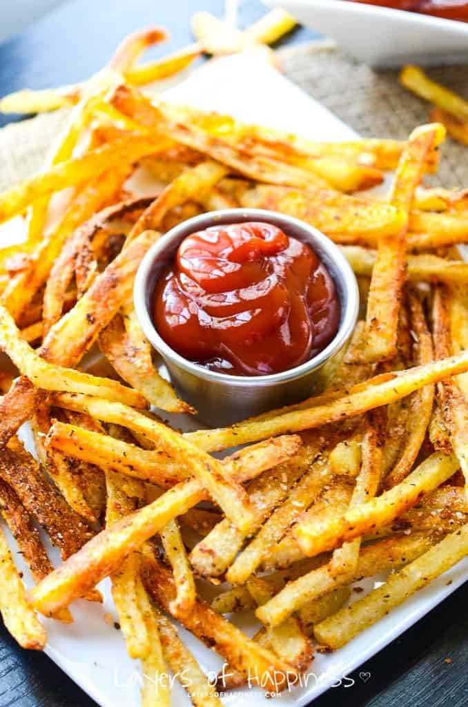 "Extra Crispy Oven Baked Parmesan French Fries Recipe | layers of happiness - ""Crispy edges, soft centers; extra-crispy French fries baked not fried – so you can feel good about eating them!"""
