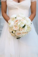 Ivory bridal bouquet of peonies, roses, garden roses and ranunculus