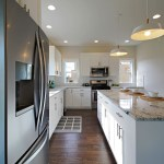 L Shaped Kitchen With White Shaker Cabinets Colonial White Granite Layjao