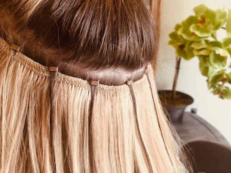 Should You Choose Beaded Weft Hair Extensions Vs Tape In?