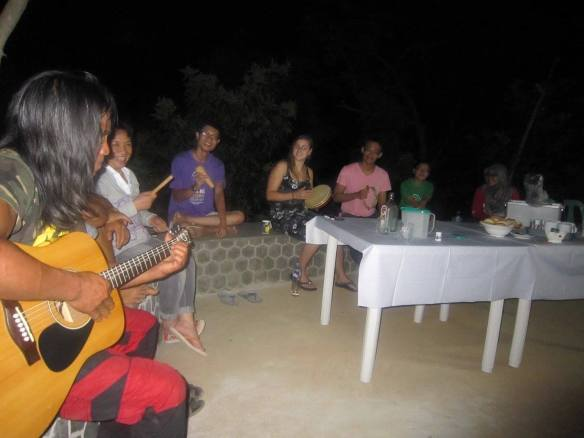 Jason with Malaysian Volunteers enjoying an evening of music layog country farm