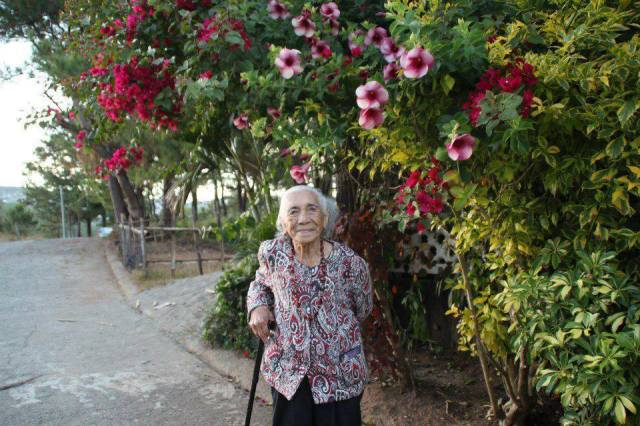 My mother infront of her house in Baguio