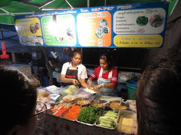 They are making Vietnamese fresh spring rolls. Veggies!